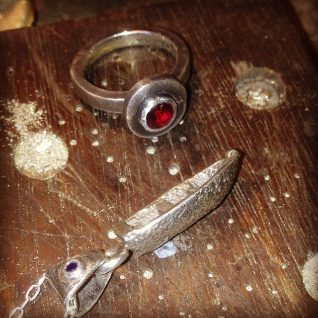 Sandcast Silver Boat pendant with Lab-grown Sapphire and a fabricated ring with a lab-grown synthetic Ruby