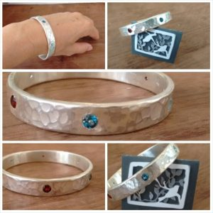 Commissioned bangle - very solid sterling silver with rubies and toapz stones all around