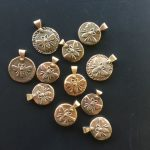 Sand-cast bronze bee pendants with silver rivets