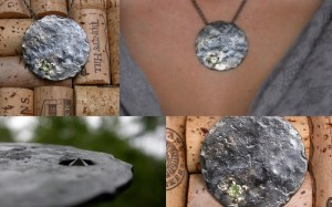 Steel, peridot and gold leaf (planet?) pendant