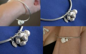 Cast gum nut cluster on sterling silver with a freshwater pearl 'acorn'